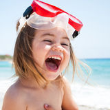 Little girl at sea with mask Royalty Free Stock Photography