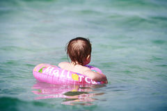 Little girl in the sea Stock Photos