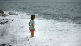 Little girl in the sea Stock Photography