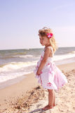 Little girl on sea shore Royalty Free Stock Photography