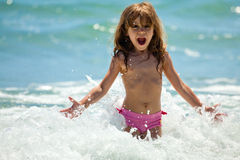 Little girl at sea in sunny day Stock Images