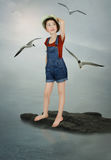 Little girl and the seagulls stock photography