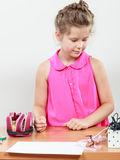 Little girl searching for her accessories. Royalty Free Stock Photography