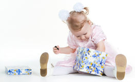Little girl is searching a present in a box Stock Photo