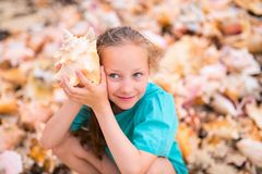 Little girl with a seashell. Portrait of adorable little girl with a seashell royalty free stock images