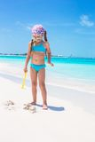 Little girl on seashore during summer vacation Stock Photos