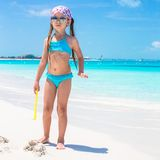 Little girl on seashore during summer vacation Stock Images