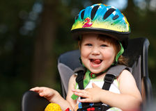 Little girl in the seat bicycle Stock Photos
