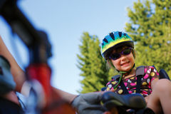 Little girl in the seat bicycle Stock Photography