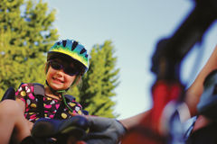 Little girl in the seat bicycle Stock Image