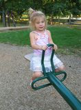 Little Girl On See-Saw Stock Photo