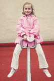 Little girl on a seesaw Royalty Free Stock Images