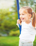 Little girl on  seesaw Stock Photos