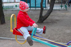 Little girl on seesaw (teeter-totter). Stock Photography