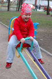 Little girl on seesaw (teeter-totter). royalty free stock photo