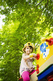 Little girl on seesaw/teeter-totter Stock Photos