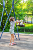 Little girl and seesaw Royalty Free Stock Photo