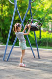 Little girl and seesaw Royalty Free Stock Image