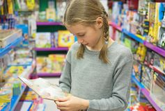 Little girl selecting toy. Royalty Free Stock Image