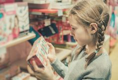 Little girl selecting toy. Stock Photos