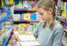 Little girl selecting toy. Stock Photo
