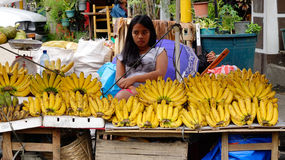 Little girl selling banana at the market Royalty Free Stock Photos