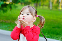 Little girl sends an air kiss Royalty Free Stock Photography