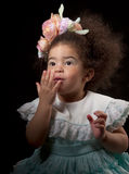 Little girl sends kiss, portrait on black Royalty Free Stock Photo