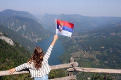 Little girl with a Serbian flag on the viewpoint Banjska stena. Tara mountain stock photography
