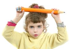 Little girl serious with big pencil in hand Royalty Free Stock Images