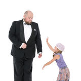 Little Girl and Servant in Tuxedo Have Fun Stock Images