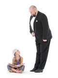 Little Girl and Servant in Tuxedo Looking at Each Other Stock Photo
