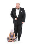 Little Girl and Servant in Tuxedo Royalty Free Stock Photos