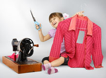 Little girl sewing. Cuting dress Royalty Free Stock Image