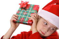Little girl shaking present Stock Images