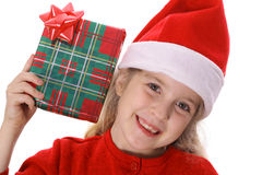 Little girl shaking present smile Stock Photos