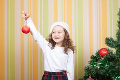Little girl sharing a toy Stock Photos