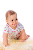 Little girl on sheepskin Royalty Free Stock Image