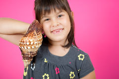 Little girl with  a shell Royalty Free Stock Image