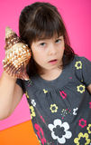 Little girl with  a shell Royalty Free Stock Photography