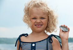 Little girl with shell Royalty Free Stock Image