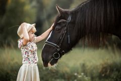 Little girl with shire horse Royalty Free Stock Photo