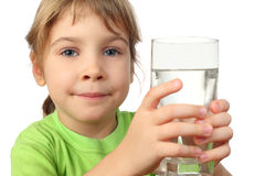 Little girl in shirt holding glass with water Royalty Free Stock Photos