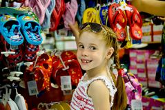 Little girl in a shoe store Royalty Free Stock Photos