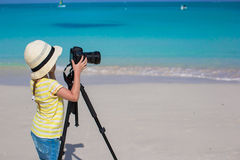 Little girl shooting with camera on tripod during Stock Images
