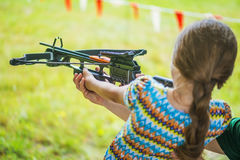 Little girl shooting crossbow Stock Photography