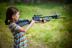 Little girl shooting crossbow Stock Image