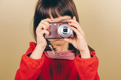 Little girl shooting a digital camera Royalty Free Stock Images