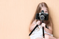 Little girl shoots on camera.  Royalty Free Stock Image