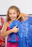 Little girl in shop of dresses Royalty Free Stock Images